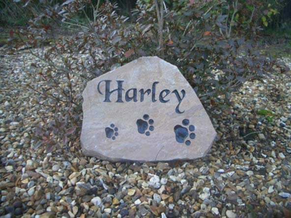 large sandstone dog memorial