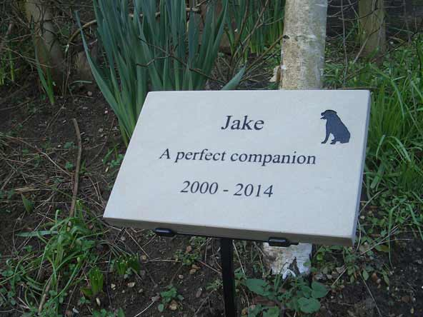 sandstone dog plaque on metal stand