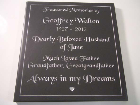 Slate plaque with engraved decorative border
