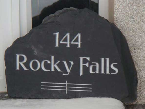 free standing and upgright stone with number 44 rocky falls