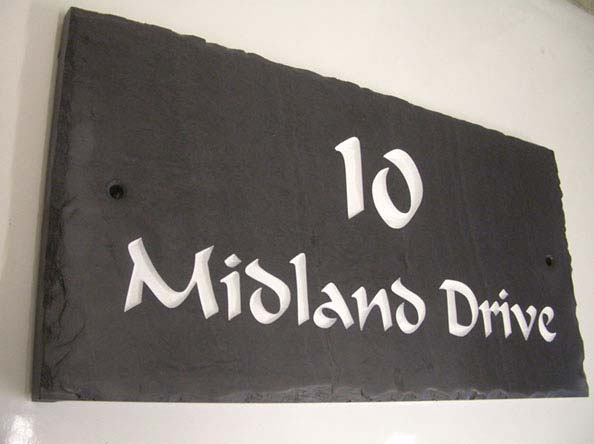 slate stone sign with engraved text number 10