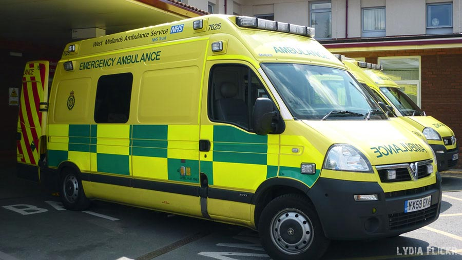 An NHS West Midlands Ambulance Service emergency ambulance, outside the Accident & Emergency department of Warwick Hospital