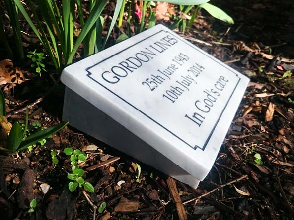 memorial stone in garden for gordon lines