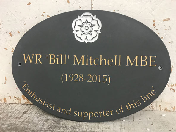 oval slate memorial plaque for bill mitchell
