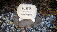 sandstone plaque on stand for pet dog buster