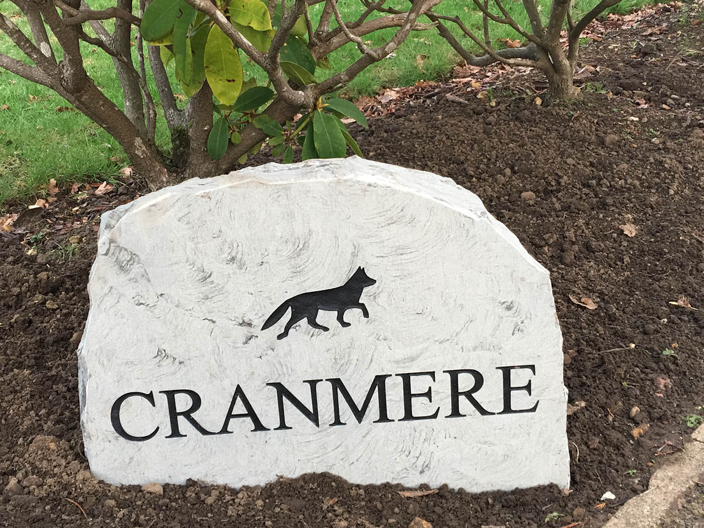 marble house sign with imprint of fox for cranmere
