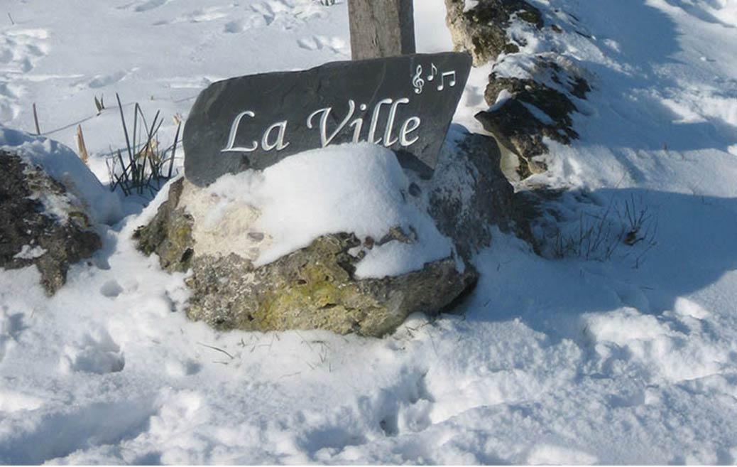 la ville freestanding house sign in snow