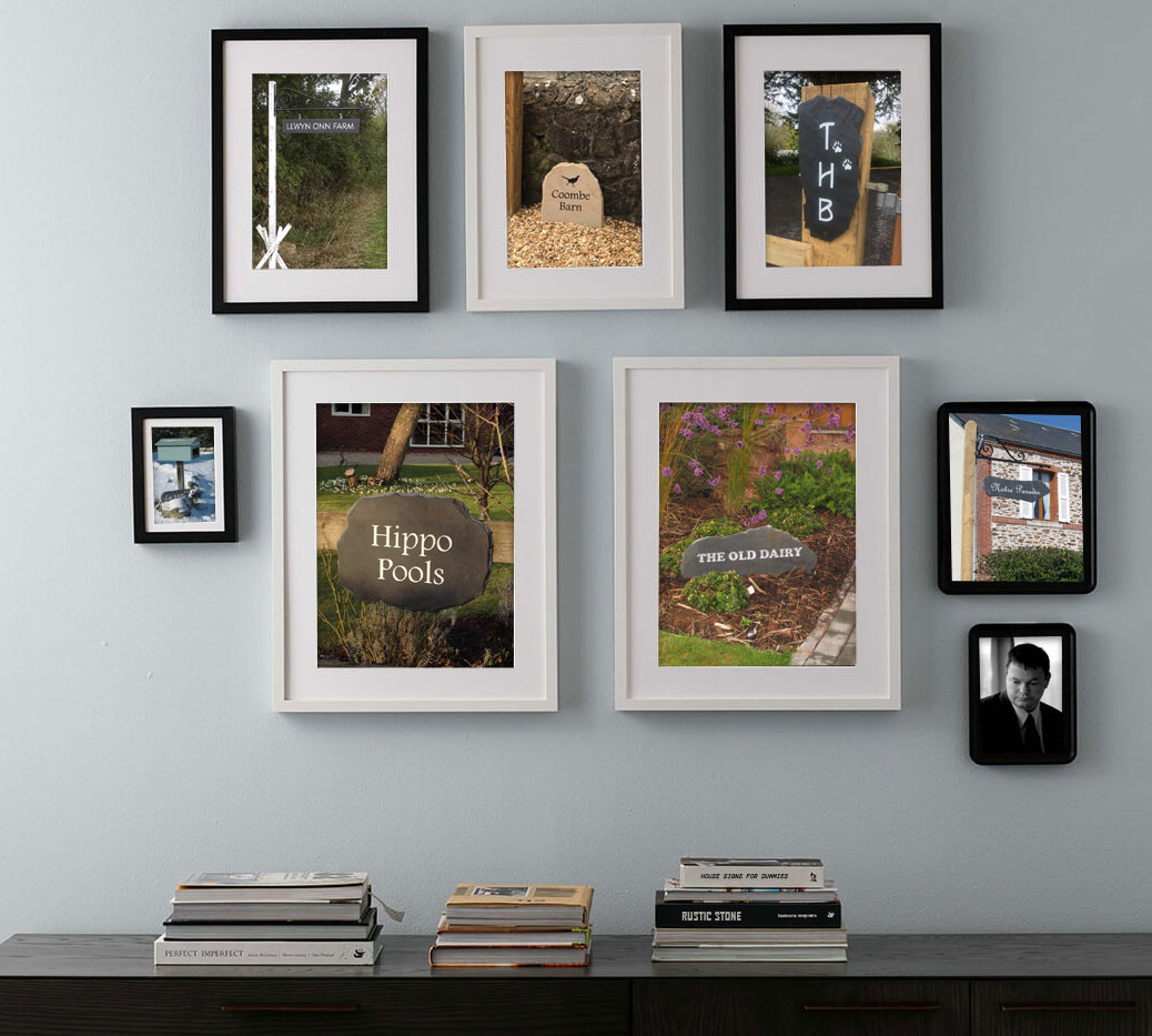 picture frames displaying various house signs