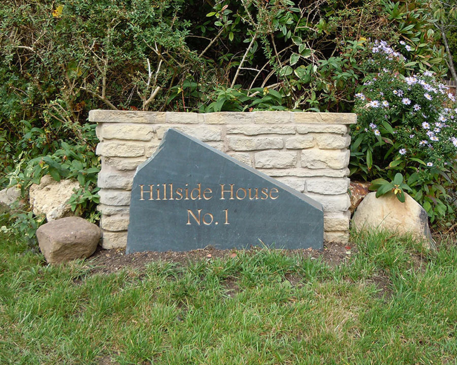 free standing house sign with text hillside house no1