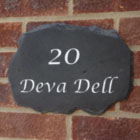 house sign attached to wall example