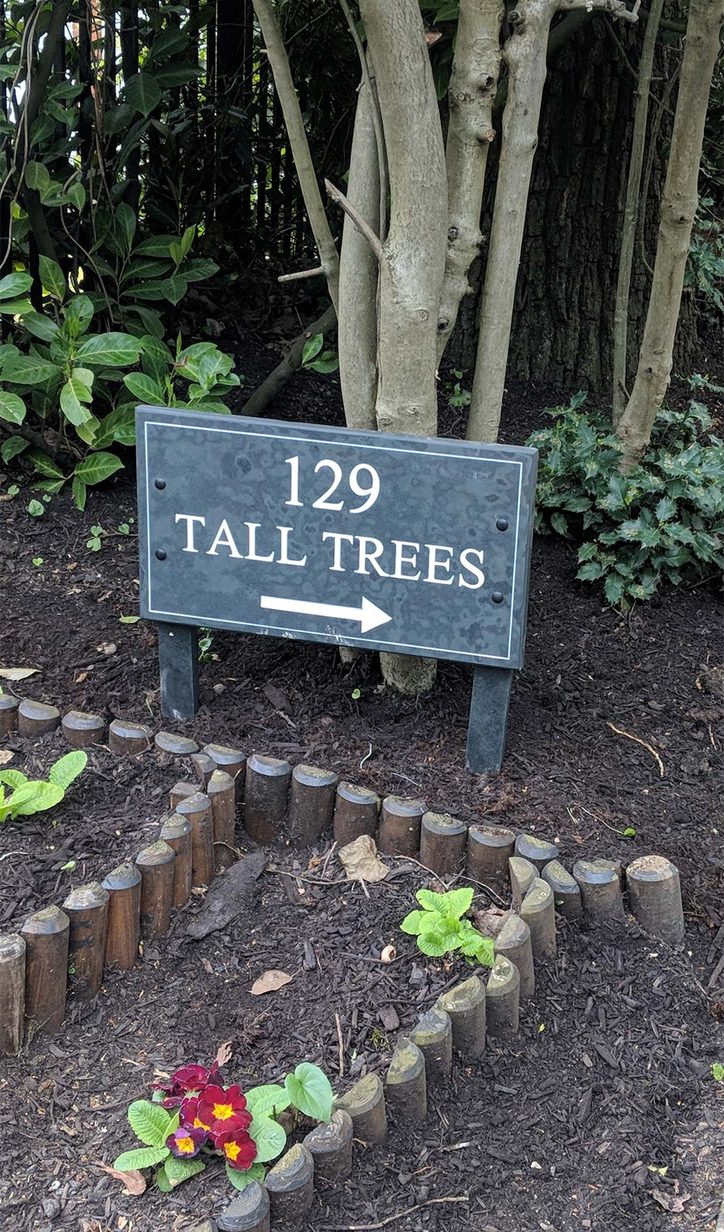 custom stone house sign for 129 tall trees