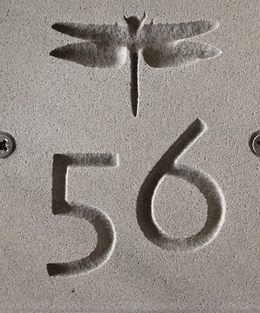 sandstone sign with number 56