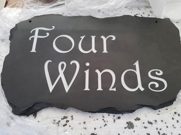 four winds house sign