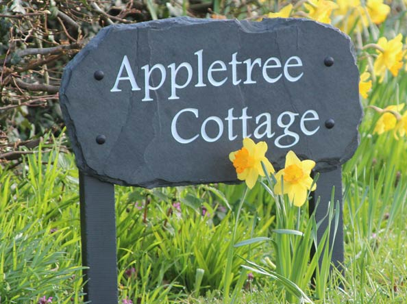 slate plaque house sign on wooden posts for appletree cottage