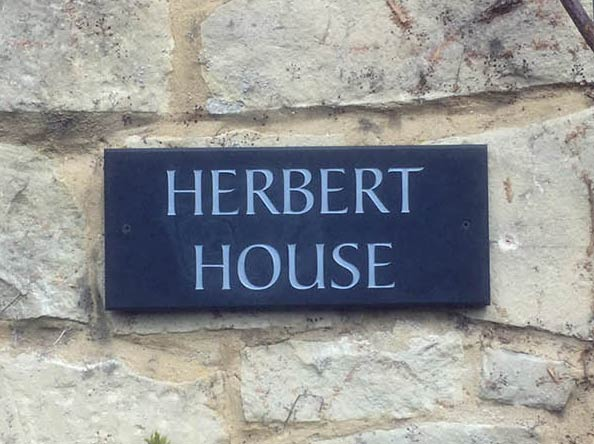 House sign plaque at back of building