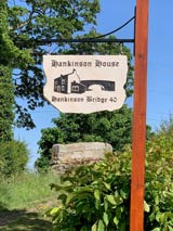 hankinson house hanging sandstone sign with metal bracket