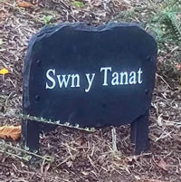 Slate House Sign Attached To Two Wooden Posts