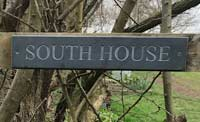 Small Slate Plaque Sign Attached To Garden Fench And Gate For South House Thumbnail
